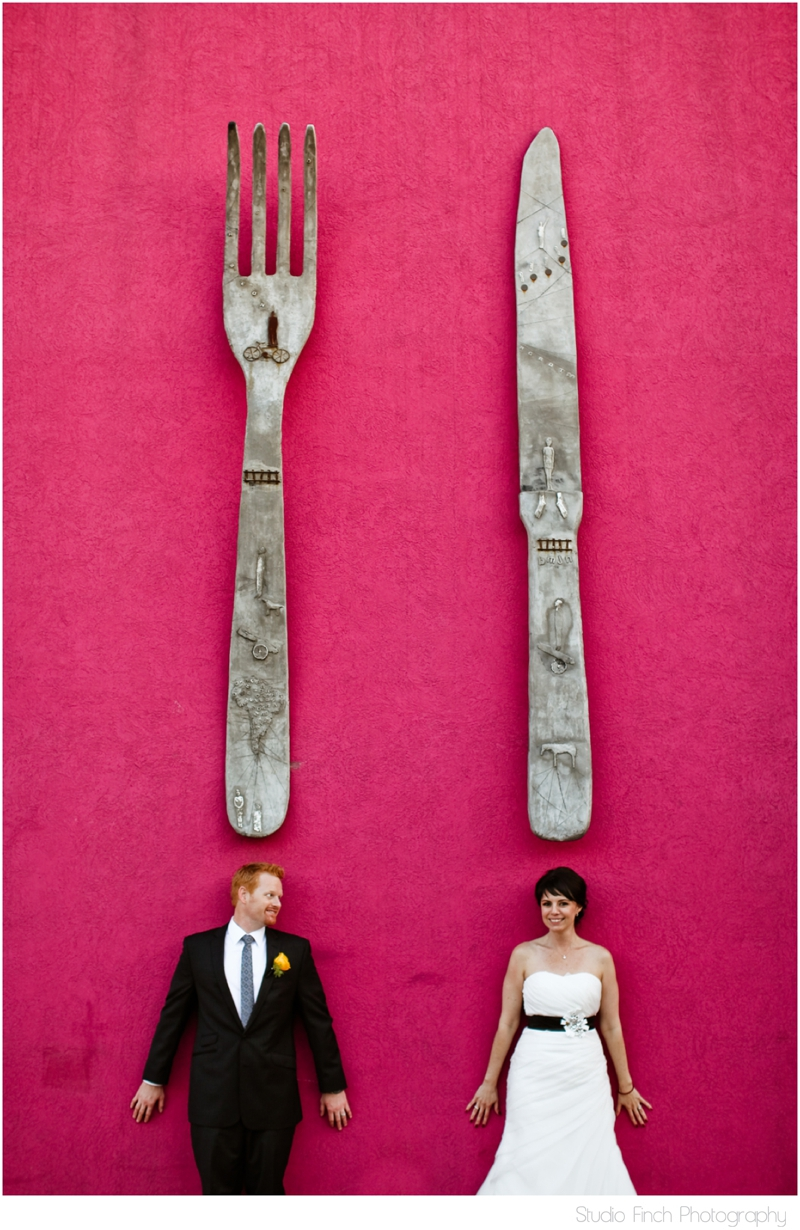 Bride and Groom Under Gian Fork and Knife Wedding Photo Molaa Long Beach California